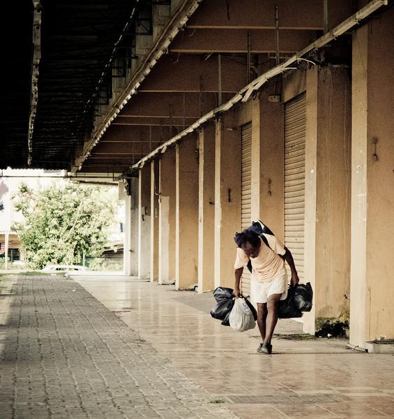 A homeless man walking in Keningau, Sabah.