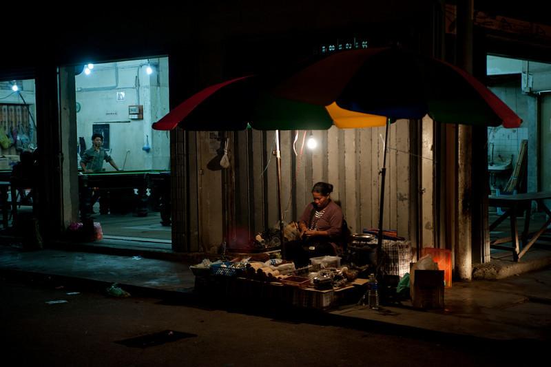 A woman selling goods in the famous Pasar Malam Keningau, Sabah.