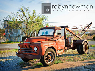 """Tow Truck in front of the Four Women on the Route restaurant that inspired the character """"Tow Mater"""" in the Pixar movie """"Cars""""."""