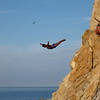 Acapulco cliff diver; middle of the cliff.