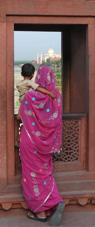 Woman and child on Fort Agra viewing the Taj Mahal.