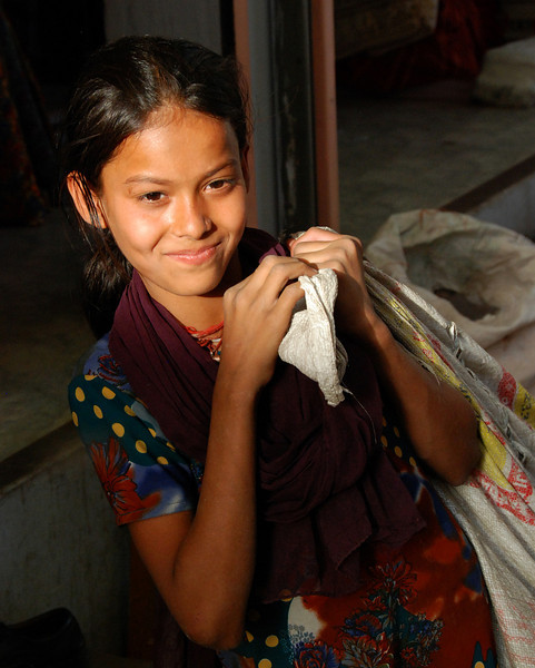 Faces of India: Young girl in market.