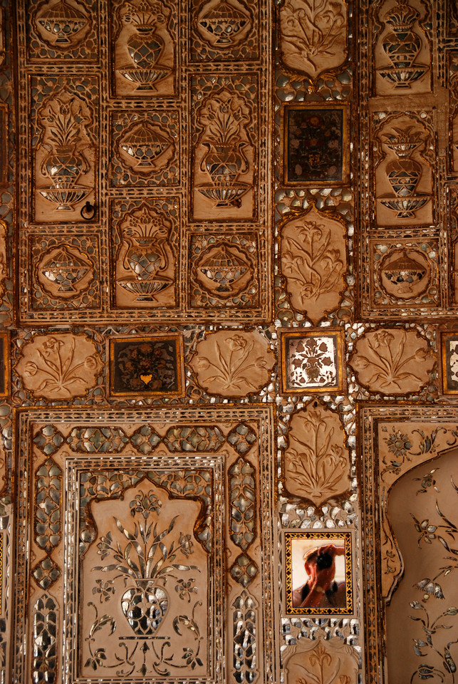 Faces of India: A wall in a palace at Amber Fort with Jay reflected in the mirror at the bottom-right.