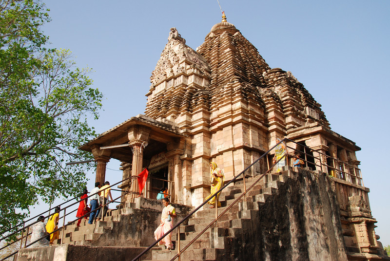 Hindus attending the active temple next to the Chandlas complex.