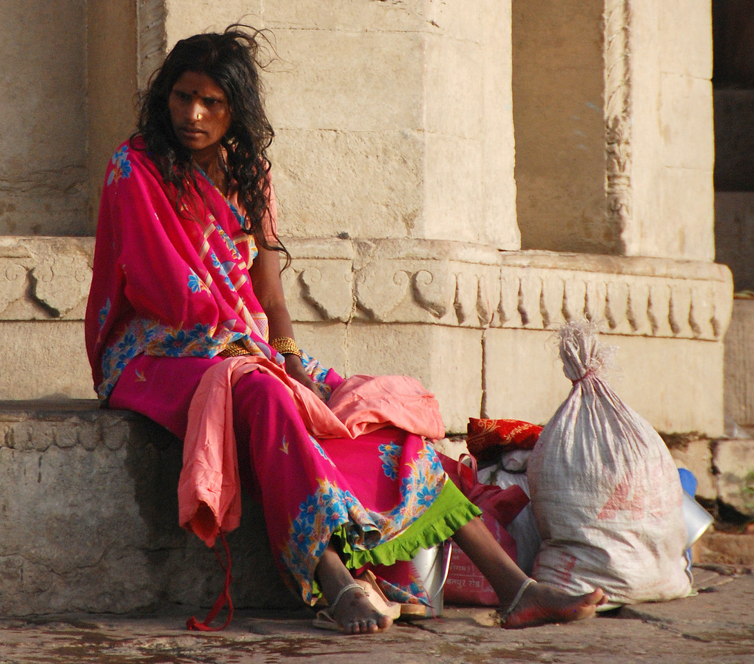 A woman tired after washing clothes in the waters of the Ganges.