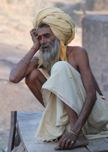 Sleepy holy man outside a Hindu temple on Fort Rathambore.