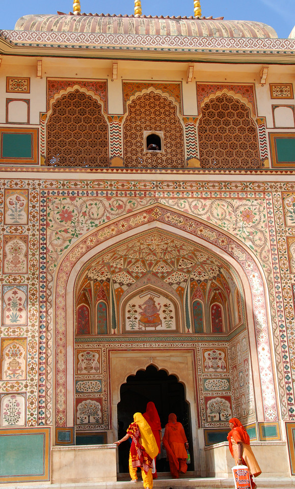 Women entering one of the palaces in the Amber Fort.