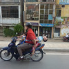 We've seen family of 5 on a single bike, with babies  held by one arm only on the side !