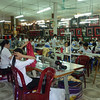 Hundreds of workers making silk clothing and decorative items.