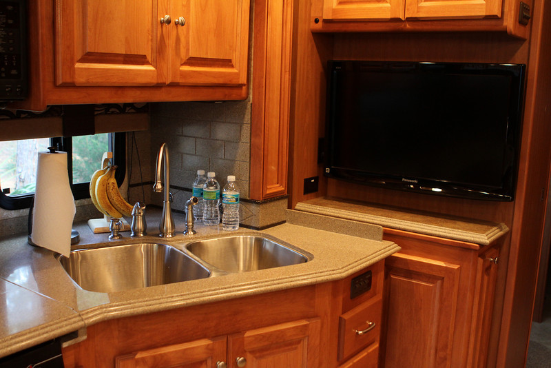 Mid-ship HD Flat Screen TV, dual stainless steel sinks.