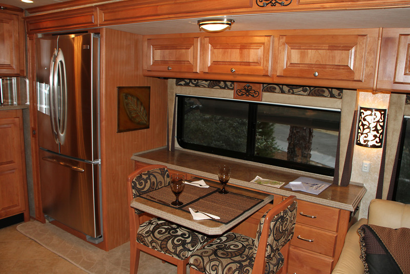 Residentail refrigerator, instead of the usual gas camping style, dinette table pulls out to seat 4.