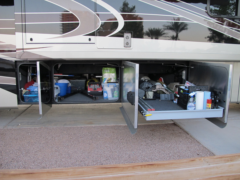 Full pass-thru basement storage, with one sliding roll out drawer, accessible from either side of the coach.