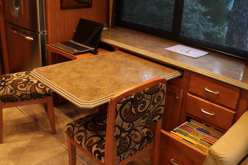 Built in computer work station, dedicated file drawer for paperwork and dinette area.