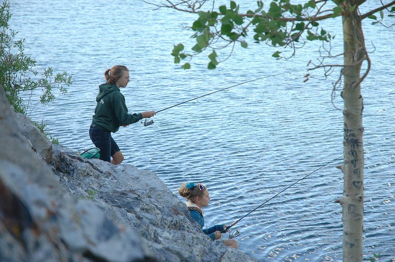 "Maddie and Katie fishing together ""on the rocks"""