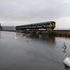 Back to the Larne Line, 454 passes Magheramorne Causeway working the 1545 Larne Town / GVS 060910