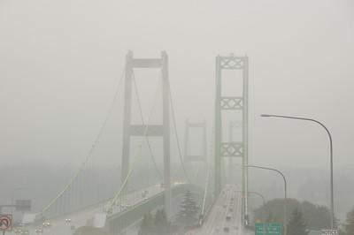 Crossing the Tacoma Narrows Bridge on a foggy day.