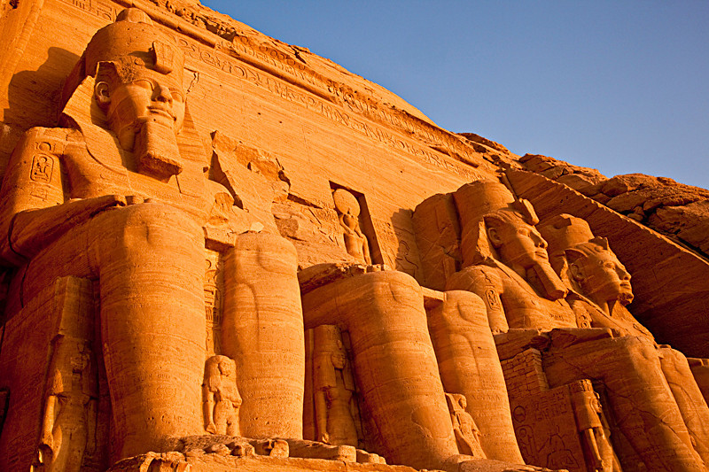 Sun Temple of Ramses II at sunrise<br /> <br /> The smaller statues between Ramses' feet represent various members of the royal family.