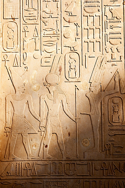 Bas-reliefs on Senurset's White Chapel depicting King Senusret I, the falcon God Horus, and the fertility God Amun-Min at Karnak's open-air museum. I'll let you figure out which one is the fertility God Amu-Min ;).
