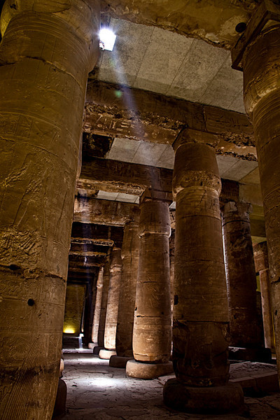 Temple of Seti I, Abydos<br /> <br /> Constructed in fine white marble by Seti I (1318-1304 BC). Cutouts in the roof allow blocks of sunlight to light up the interior of the Second Hypostle Hall.<br /> <br /> Abydos is a little bit out of the way from the normal touristy route, so you won't see as many visitors here as you usually do at other temples. It takes about 3 hours by car one way to reach here from Luxor, but I think it's a very worthy temple to visit. It's well-known for the exquisite bas-relief carvings on its walls, and the intact roof and lower height of the columns in the hypostle hall give it an intimacy that I think other more well-visited temples lack.