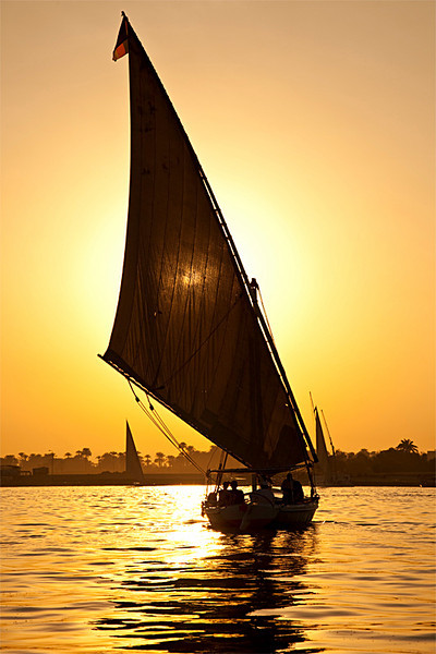 Felluca sailing on the Nile at sunset. Luxor.