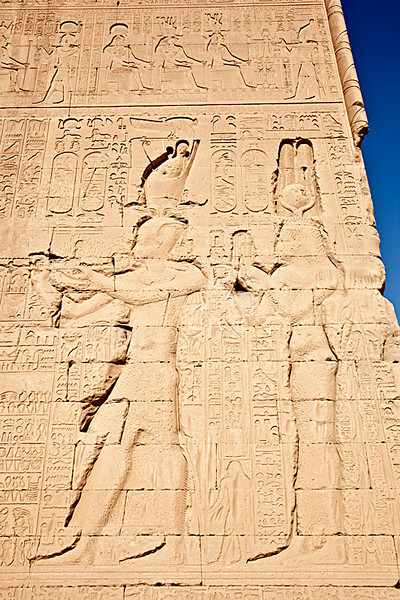 Cleopatra (right) and son Caesarion on the back wall of Temple of Hathor.