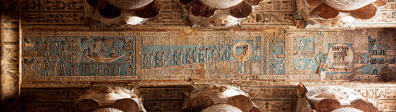 "Astronomical reliefs on the ceiling of the Hypostle Hall at the Temple of Hathor, Dendera.<br /> <br /> This row ""begins with the Eye of Re in its barque, above which appear the fourteen days of the waning moon. Beyond the full moon in the centre come the fourteen stages of the waxing moon (each with its own deity), culmunating in the full disc worshipped by Thoth, and lastly the moon as Osiris, protected by Isis and Nephthys. Souls in the form of jackals and birds adorn Re's barque as it journeys across the sun's register.""   - from The Rough Guide to Egypt."