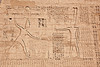 First Pylon (front gate) of Medinet Habu<br /> <br /> Carvings of Ramses slaying Nubian prisoners watched by the deities Amun and Ptah.