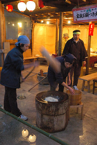Making mochi - pounding cooked rice and warm water with a big mallet.
