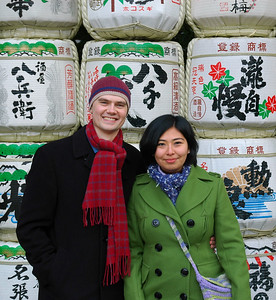 In front of a wall of sake barrels at the Ise shrine.