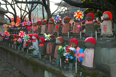 Small bhuddas like these are seen all over Japan. These are at a temple near the Tokyo Tower.