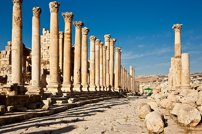 The city's main thoroughfare 'cardo maximus'. Jerash.<br /> <br /> 500 columns once lined the street. Some were built at uneven heights to complement the facades of the building that once stood behind them.