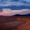 Wadi Rum at dawn.<br /> <br /> I paid for a sunrise tour and thought that I would be driven deep into the desert to watch the sunrise, but we...um... were  only taken about half a mile away from camp. The sky actually got a deeper red color a few minutes after I had already packed my camera away. I should have known better !!!