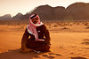 "Ramadin, my driver for the tour of the Wadi Rum desert.<br /> <br /> Ramadin was one of the nicest people I met in Jordan. The only hiccup was that he didn't speak English, and I didn't speak Arabic. I had no idea where he was driving me to most of the time. He would stopped his jeep at some destination in the desert, say ""picture"", and I would hopped out of the car and snap my camera. Not the most ideal way to do photography, but it was good enough for what it was at the moment. I hope one day to be able to get back to Jordan and take a proper tour of the Wadi Rum desert."