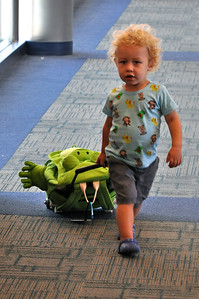 Everett with his new frog suitcase at the Milwaukee airport