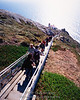 The stairs leading down to the Point Reyes lighthouse (Tom Kelly ascending just right of center)