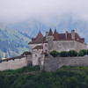 Switz005 The roofline on this castle echoes the jagged silhouette of the mountains in Switzerland