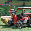 Switz014 Harvesting the precious grass   Where it's too steep even for these small machines, they scythe by hand  Nothing is wasted