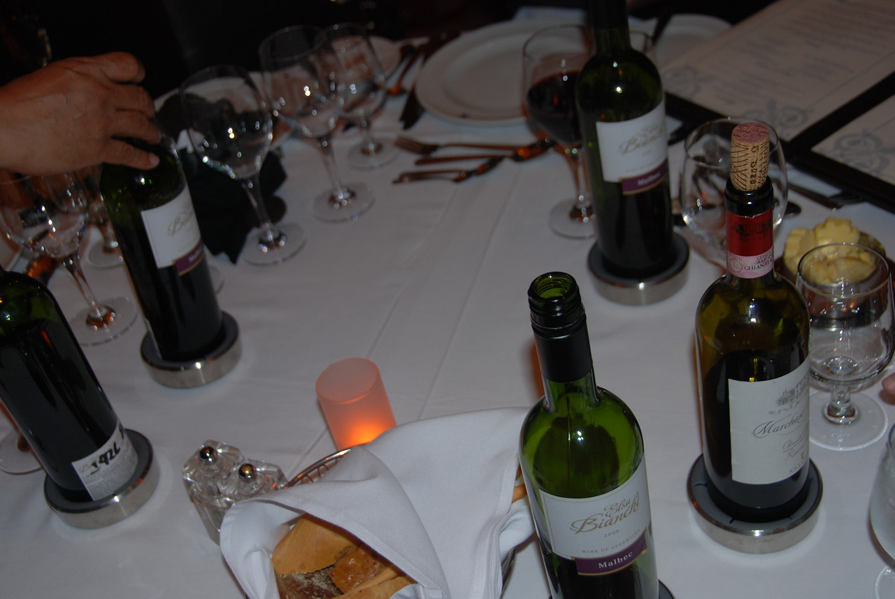 That's a lot of wine bottles for one table!