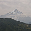 """Machhapuchhre means """"fish tail"""" in Nepali. Believed to be sacred to Shiva, this mountain has never been climbed to its summit."""