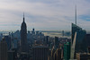View South with Empire State Building dominant and new Freedom Tower rising behind it. Statue of Liberty in the far distance.