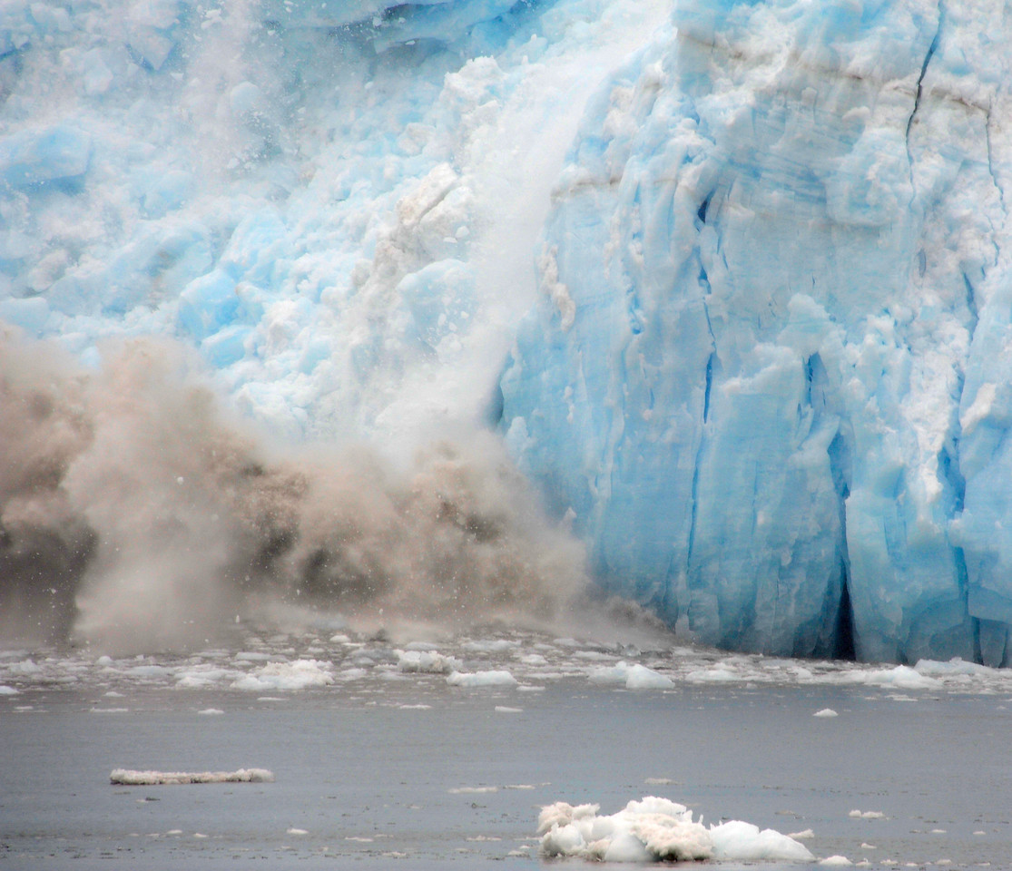 GLACIERS: Calving of the Aialik glacier (sheets of ice falling into the water causing a loud roar and a big splash).