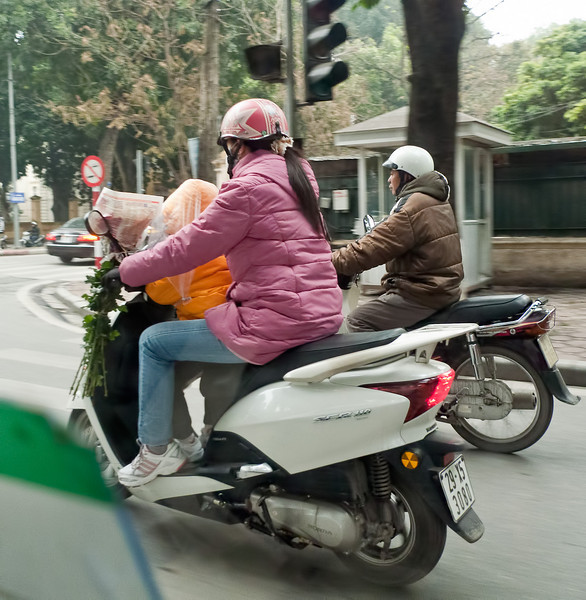 From a cab window:  Helmets are officially required though not always worn.