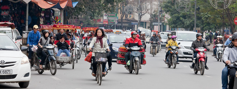 Crossing a wide street like this one is scary.  There are few traffic lights and traffic is continuous.  The approved crossing method is just to walk across at a steady pace and rely on the traffic to avoid you.