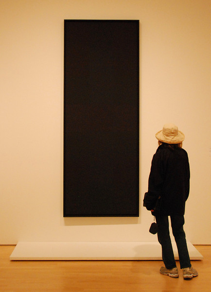 A work of art... viewing a solid black painting at the art museum.