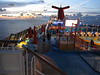 """A view looking aft. The Carnival cruise ships all have """"whale tale"""" smokestacks."""