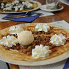 Dutch pancake with rum soaked raisins, whipped cream & ice cream.