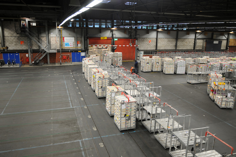 The Flower Auction in Aalsmeer. The world's largest flower auction house. Here the flowers are being moved by conveyor from the refrigeration area to be prepared for auction.