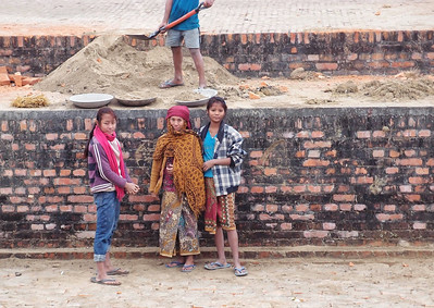 Three young girls working as construction workers in Lumbini, Nepal