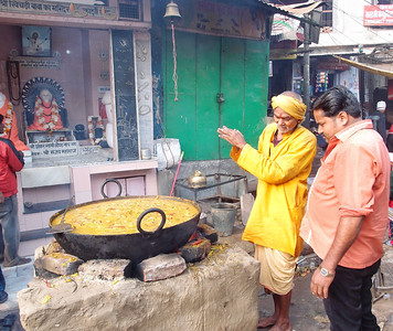 Cooking at an outdoor temple in Varanasi