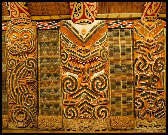 Detail from a Maori meeting house (whare runanga) at the Auckland War Museum.  I used the face on the center pillar for my annual jigsaw puzzle.  It has been pretty challenging.<br /> <br /> Auckland, New Zealand<br /> 005